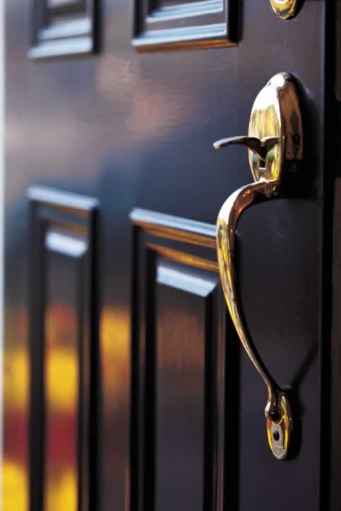 Black Four Panel Exterior Door Finished with a Brass Door Handle