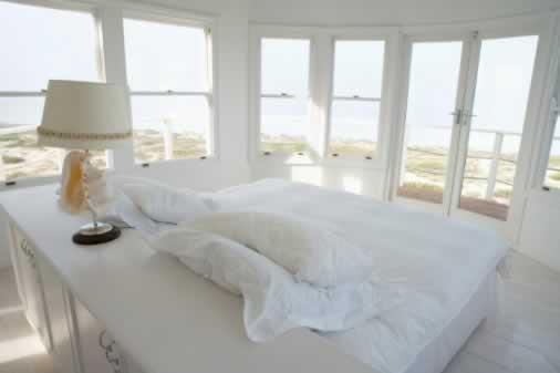 Double Hung Windows Let the Sea Breezes Blow Through Dunes' Edge Bedroom
