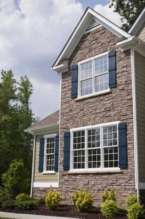 Double-Hung Windows Play with Shadows on Exterior Accent Wall