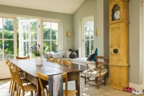 Casement Windows Complete a Sunny, Rustic Dining Room