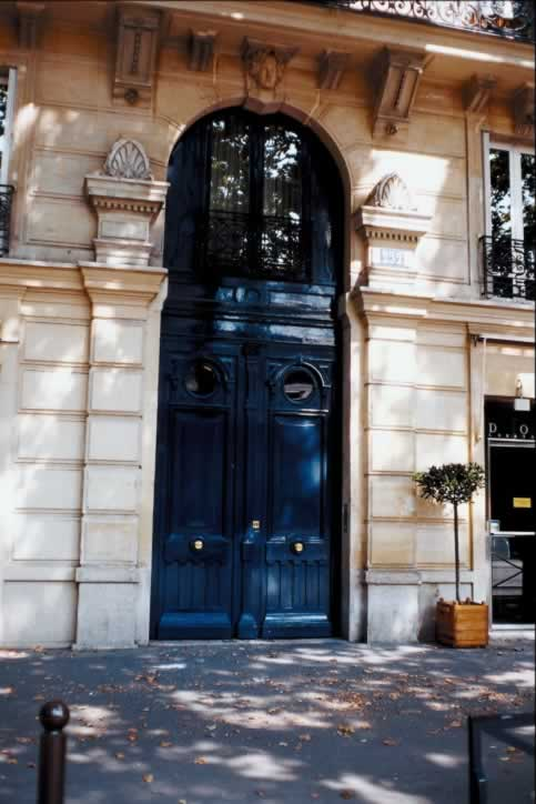 Stone Building with Huge Dark Blue Exterior Doors with Round Windows