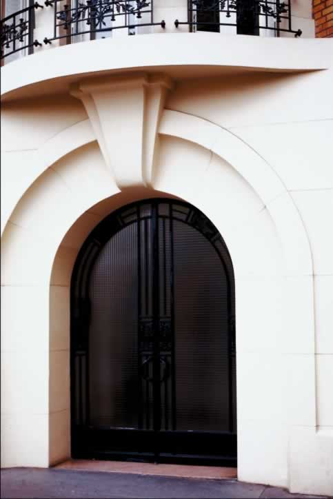 Simple, Clean White Stone Archway with Dark Double Doors