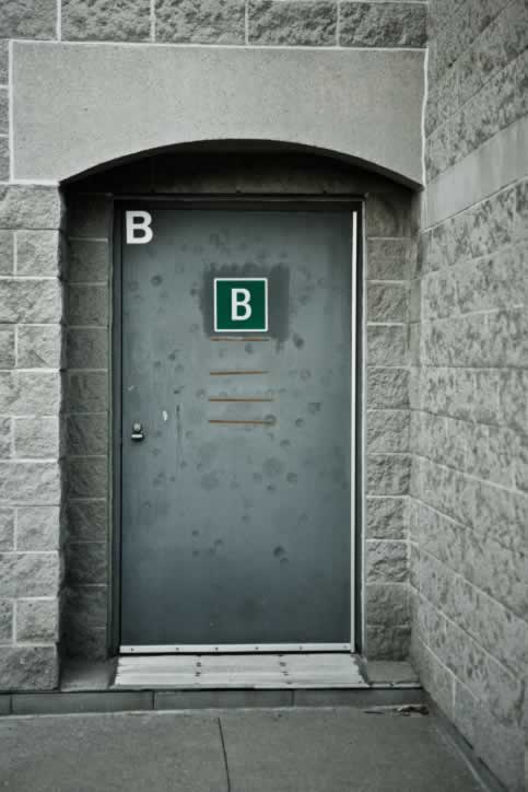 gray metal exterior door marked with the letter b door