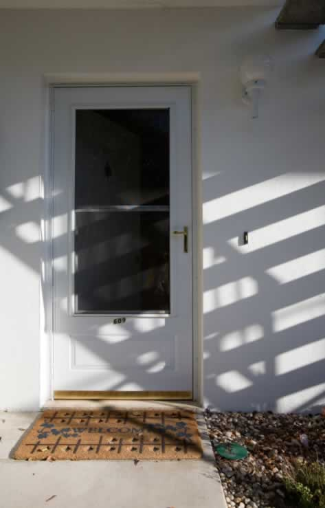 White Storm Door with Sash Window, Bronze Hardware and Welcome Mat