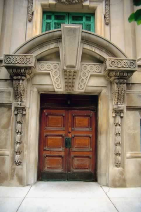 /doors/types/panel/carved-stone-arch-door-way-double-wooden.php