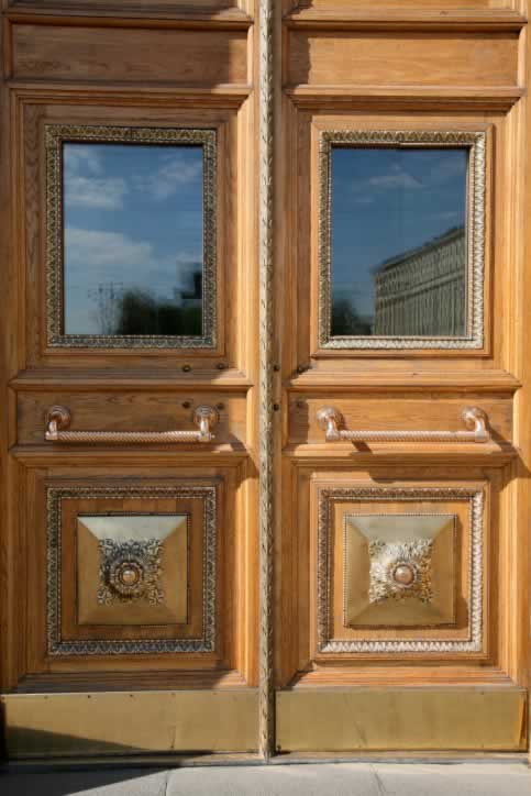 Double Exterior Two Panel Oak Doors with Gilded Molding, Mirrors, and Ornaments