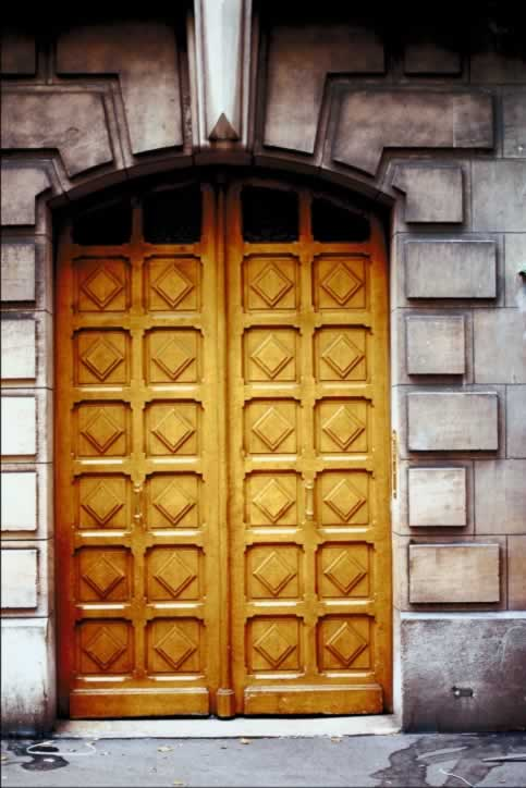 Gray Stone Building with Fourteen Panel Wooden Double Doors