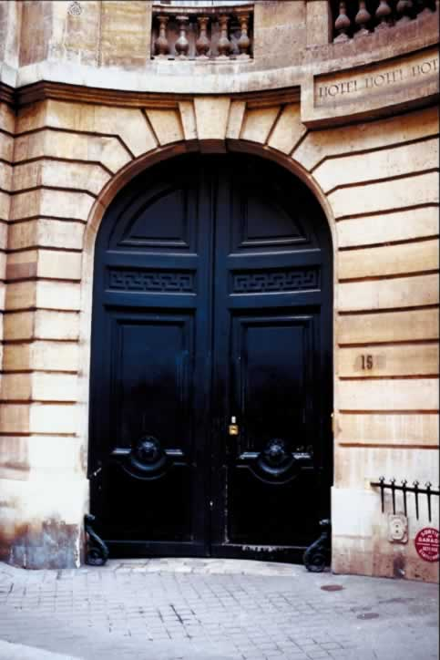 /doors/types/panel/concave-stone-wall-arch-and-huge-blue-double-doors.php