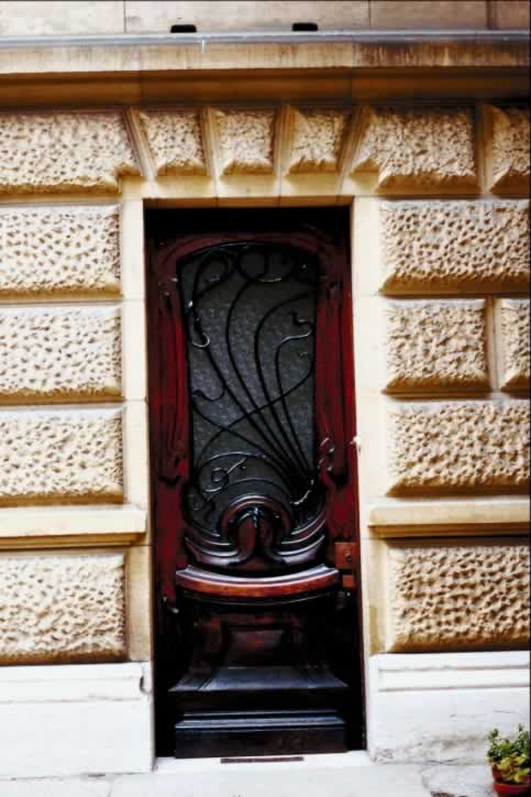 Textured Stone Building with Contemporary Mahogany Exterior Door