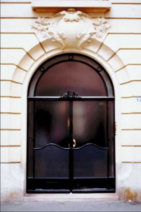 Black metal and Frosted glass Double Doors in Creamy Stone Archway