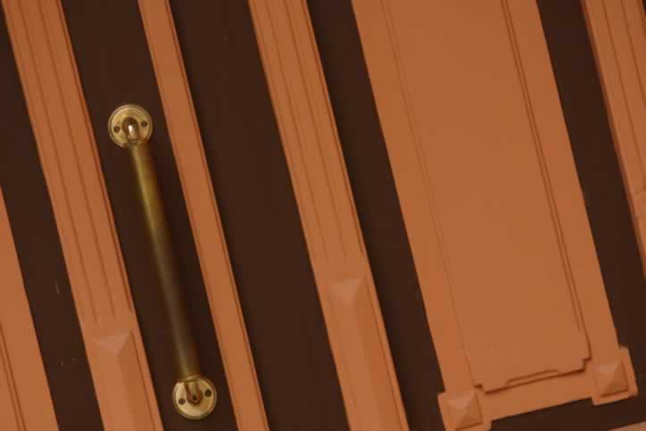 Two Toned Brown and Orange Wooden Panel Door with Brass Handle