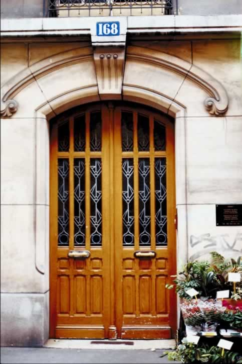 Sixteen Panel Double Wooded Doors with Leaded glass