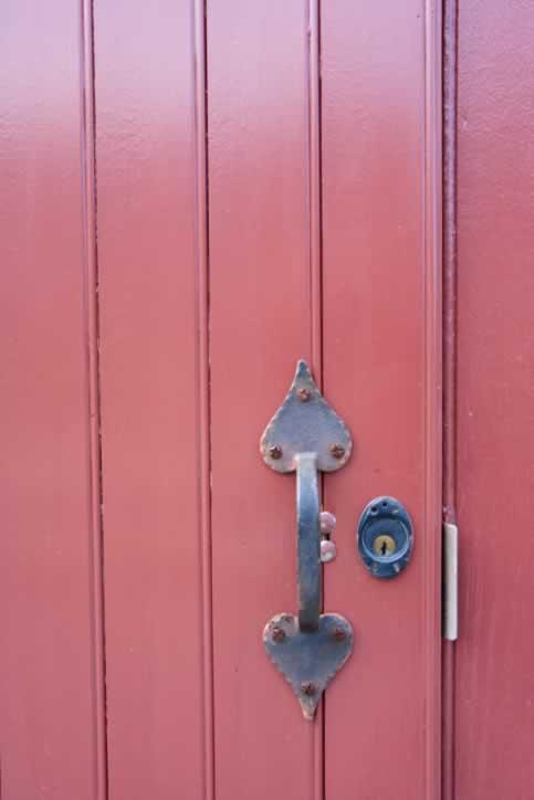 Pink Plank and Batten Wooden Door with Heart-Inspired Wrought Iron Door Handle