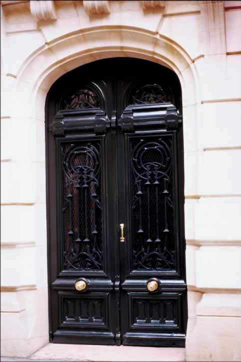 Elegant Glossy Black Exterior Doors in Elliptical Arched Doorway