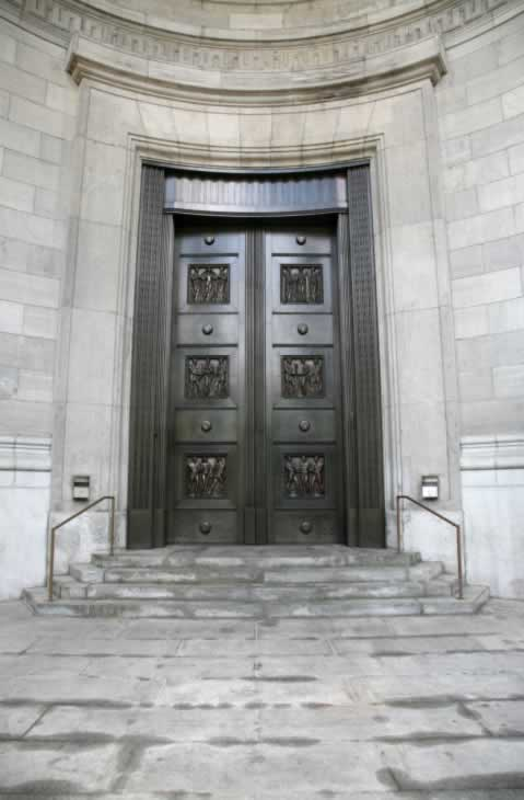 Ancient-Styled Enormous Double Bronze-Sheathed Doors with Sculpted Panels Open on Pivots