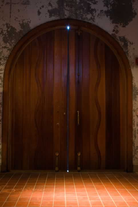 Plank and Batten Double Doors with In-laid Wooden Detail and Brass Hardware