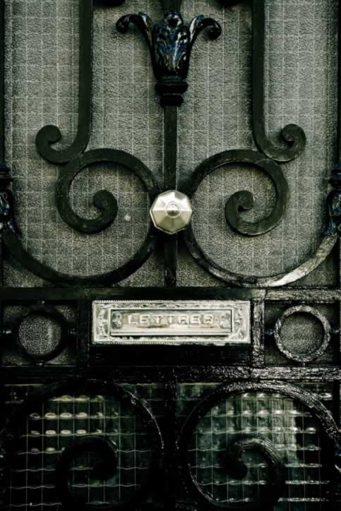 Hammered metal Door with Black Iron Scrollwork and Mail Slot