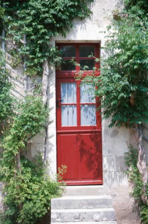 White Brick Home with Red Dutch Door with Lites
