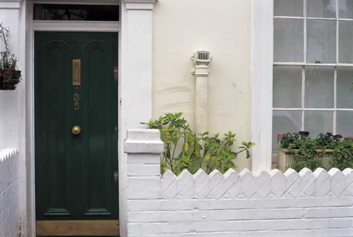 Hunter Green Exterior Door with Arched Panels and Vertical Mail Slot