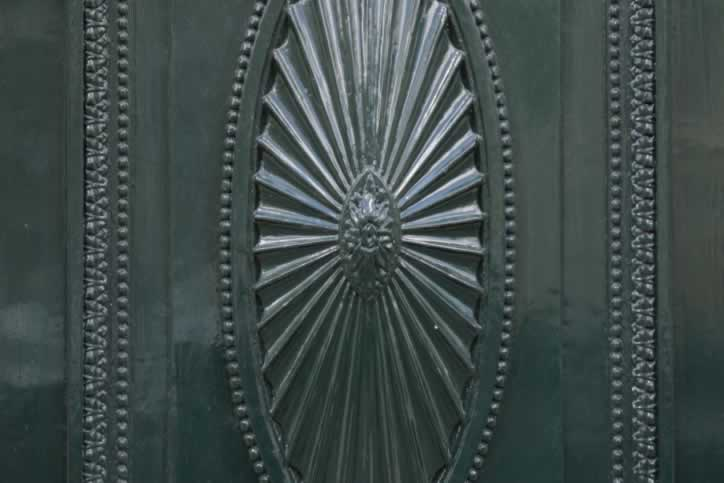metal Door with Pleated Oval Center and Beautiful Bead Detailing