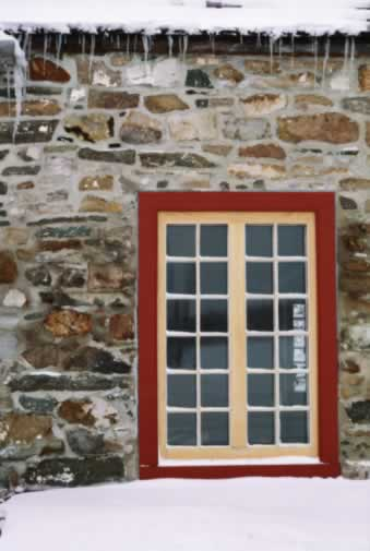 Window Sets the Whole Tone for a Fieldstone Building