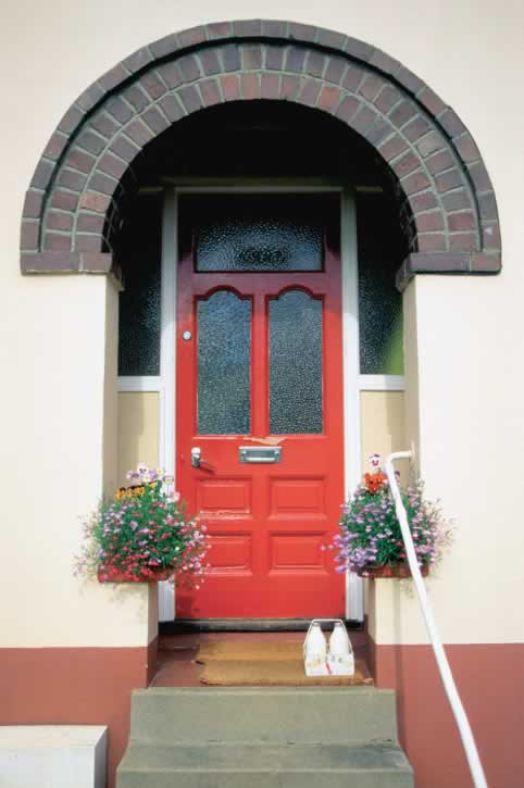 Red Seven Panel Exterior Door with Three Textured glass Lites
