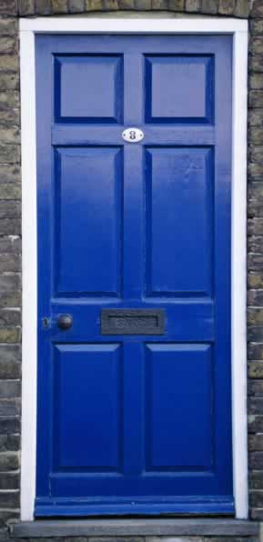 A Cobalt Blue Panel Door That Says ...