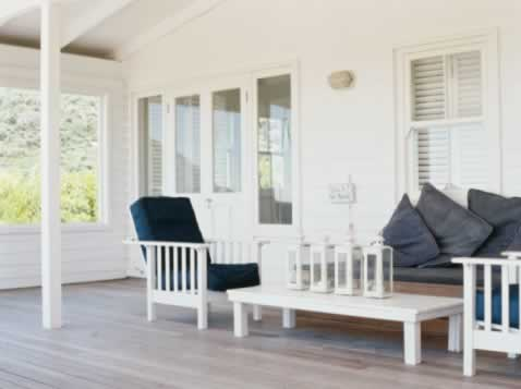 Protected Sea-Side Porch with Insulated Windows Boasts a Natty Naval Look