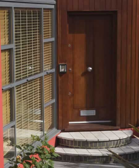 Combining Traditional Wood Doors and Metallic Hardware